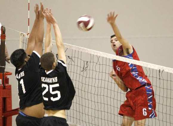 Fountain Valley's Scott Cronick, right, puts the ball past two Ocean View blockers.