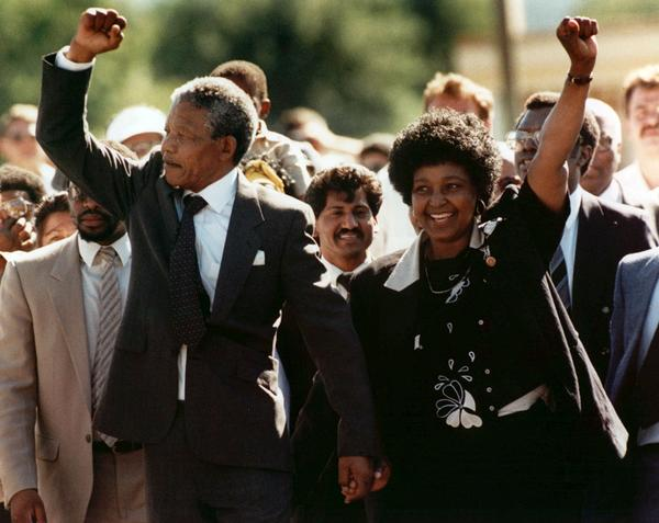 Nelson Mandela and wife, Winnie, walking hand in hand, raise clenched fists upon his release from Victor prison in Cape Town, South Africa, on Feb. 11, 1990.