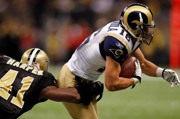 Rams receiver Danny Amendola makes a reception against Roman Harper and the Saints.