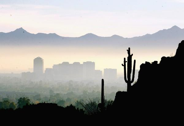 Phoenix sits in a bowl in a hot desert; heat waves and windstorms visit its 4.3 million residents regularly.