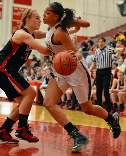 Bethlehem Catholic's Kalista Walters (32) dribbles against Honesdale's Natasha Hessling (21) during a PIAA 3A girls basketball second-round game held at Hazleton High School on Wednesday.