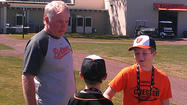SARASOTA, Fla. — Just before Wednesday's workout began at the Ed Smith Stadium Complex, Orioles manager Buck Showalter called for 10-year-old Johnny Oates II and his younger brother Jackson to hop the fence and join the team on the field.