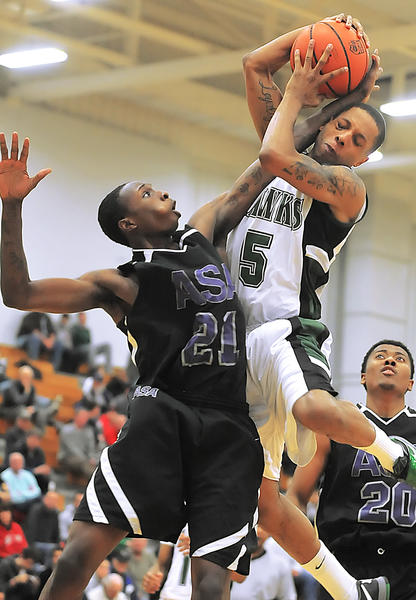HCC point guard Jerel Carter (5) will do whatever is necessary  even rebounding  to help the Hawks succeed.