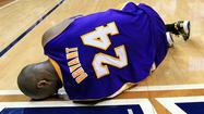 Kobe Bryant sprains left ankle in Lakers loss, out indefinitely