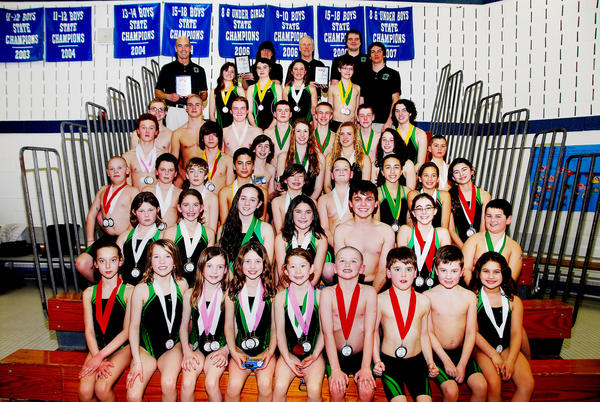 The Harbor Springs Hammerhead swim team finished in third place in the Michigan Team Swim League State Championship at Alma High School. Team members are front (from left) Suzy Carpenter, Olivia Nemic, Megan Novak, Ava Baker, Annabelle Wilder, Aiden Tanis, Will Cabana, Evan Whitfield, Alyssa Glaser; second row, Elle Carter, Hailey Tanis, Lilly Chamberlin, Alexis Glaser, Collin LaPairie, Lucy Chamberlin, Zach Birchfield; third row, Jake Maki, Connor Liddy, Pete Keiser, Austin Rose, Kobe Wilder, Tommy Frascone, Julianna Rose, Gabriella Rose, Emily Dudd; fourth row, Cooper Carpenter, Gabe Wilder, Kurtis Alessi, Kaitlyn Alessi, Danielle Paquette, Bekah Loesch, Jake Schornak; fifth row, Emory Fralick, Joshua Walker, Travis Seagman, Michael Gorman, Matthew Lively, Tommy Gardner, Megan Gardner; sixth row, assistant coach John Mastenbrook, Emily Keller, Jessica Mills, Alexis Hoffman, Chucky Thompson, assistant coach Caleb Walker; seventh row, co-head coach Marilyn Early, co-head coach John Cowing and assistant Phil Marihugh. Absent, Zoey Basta, Jillie Gretzinger, Natalie Gretzinger, Veniece Gretzinger, Brooke Harris, Jacquelyn ONeill, Ainsley and Stewart Osterlund, Craig Garrow, Charlie Pizzuti , Will Pizzuti and Pierce Whitman.
