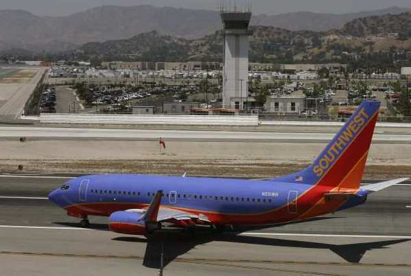 A Southwest jet taxis for take off at the Bob Hope Airport in Burbank where a temperatures beat the record high on Wednesday.