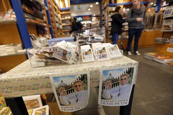 Cards with a picture of the newly elected Pope Francis are displayed at a souvenir shop in Vatican City.