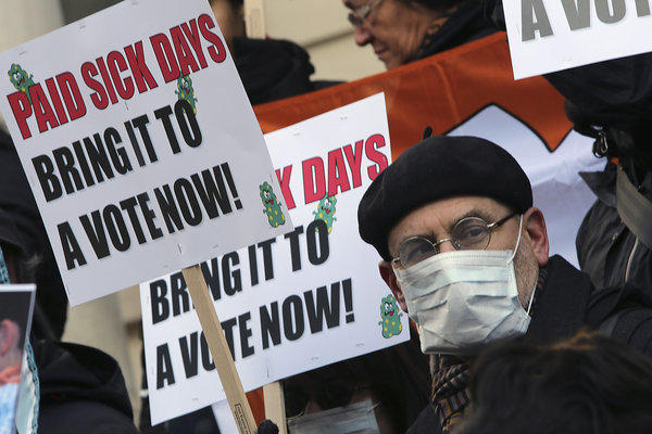 Portland became the fourth city to mandate employers provide sick leave to workers. Worker rights advocates have pushed for such measures in several U.S. cities. Above, activists rally in January at New York's City Hall for paid sick leave.