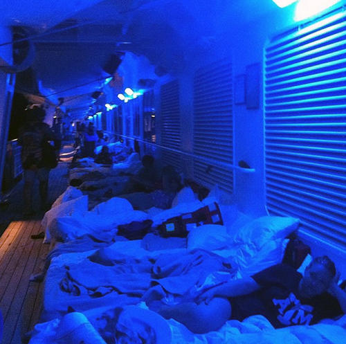 An Instagram photo provided by a passenger of the Carnival Cruise Ship Triumph identifying himself as Mikemoonpie shows passengers laying on mattresses on the third deck of the ship as she is towed toward Mobile, Alabama, on February 13, 2013.