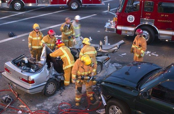 Costa Mesa firefighters work to free victims of a fatal two-vehicle crash in 2005. The driver of the Acura was arrested on suspicion of drunk driving and vehicular manslaughter.