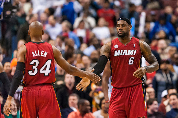 Miami Heat forward LeBron James (6) celebrates with guard Ray Allen (34) during the fourth quarter against the Philadelphia 76ers at the Wells Fargo Center. The Heat defeated the Sixers 98-94.