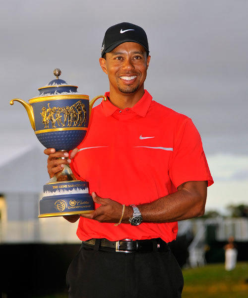 Tiger Woods holds his trophy for winning the WGC Cadillac Championship at Trump Doral Golf Club.