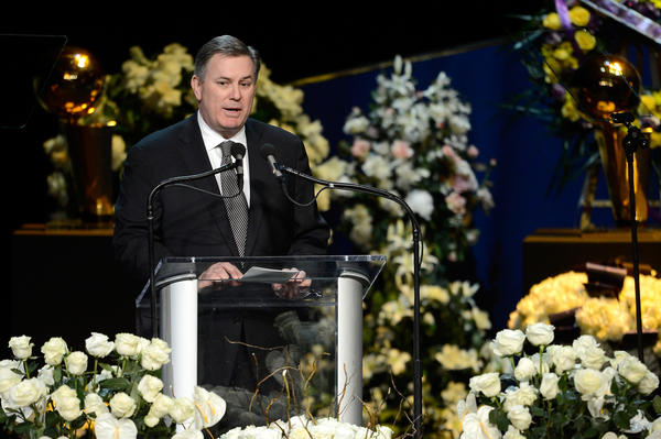 Tim Leiweke, shown speaking at the memorial service for Lakers owner Jerry Buss, will be leaving AEG.