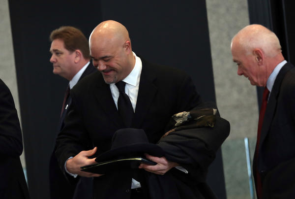 Former Chicago Bears player Chris Zorich arrives at the Dirksen U.S. Courthouse in Chicago.