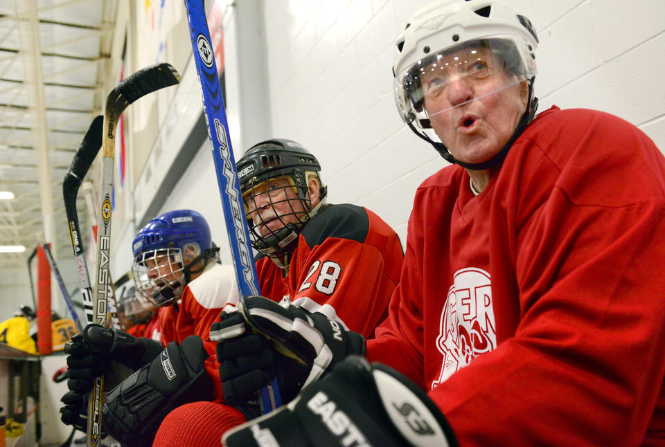 Left to right, Frank Early, Clark Torrell and Tom Wilkinson, members of the Gerihatricks, wait to rotate in to play hockey at The Gardens Ice House in Laurel, Md., in February.