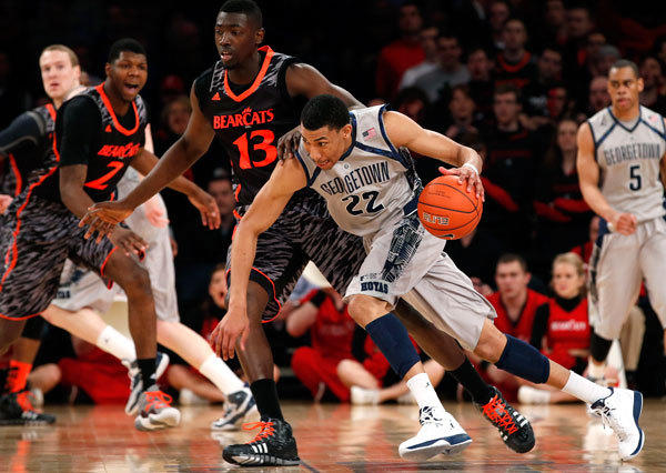 Georgetown Hoyas' Otto Porter (22) drives past Cincinnati Bearcats' Cheikh Mbodj (13) during the first half of their NCAA men's college basketball game at the 2013 Big East tournament at Madison Square Garden in New York, March 14, 2013.