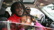 South Side rapper Chief Keef walked out of the Cook County Juvenile Temporary Detention Center in a red diamond-studded coat this afternoon after completing his 60-day sentence for violating his probation for a gun conviction.
