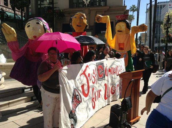 Protesters converge outside Urasawa on Rodeo Drive after the famed sushi restaurant was cited over labor violations.