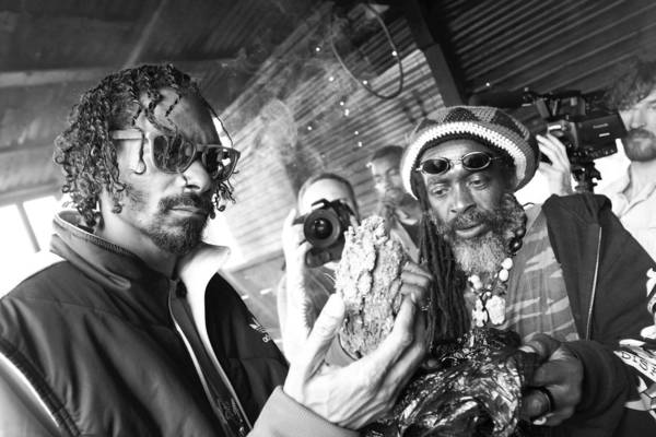 "Snoop, left, is seen in ""Reincarnated"" visiting Jamaica last year, a trip that became a spiritual journey."