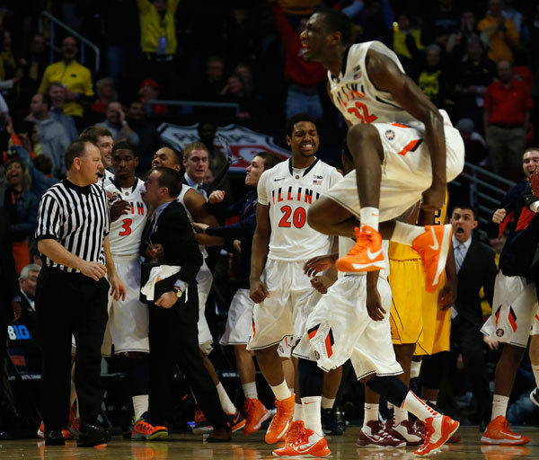 Illinois Fighting Illini's Nnanna Egwu (R)and Myke Henry (20) celebrate the game winning basket by Brandon Paul (3) against the Minnesota Golden Gophers their NCAA men's college basketball game at the 2013 Big 10 tournament in Chicago, Illinois, March 14, 2013.