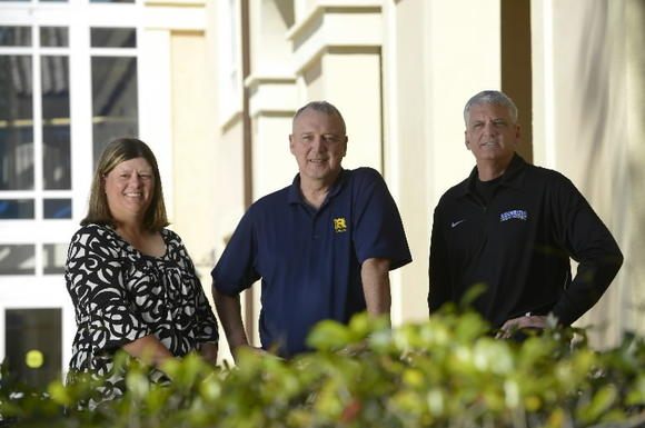 Rollins coaches Michelle Frew (softball), Tom Klusman (men's basketball, center) and Glenn Wilkes Jr. (women's basketball) each surpassed 600 victories for the Tars this school year. (Phelan M. Ebenhack, Special to the Sentinel)