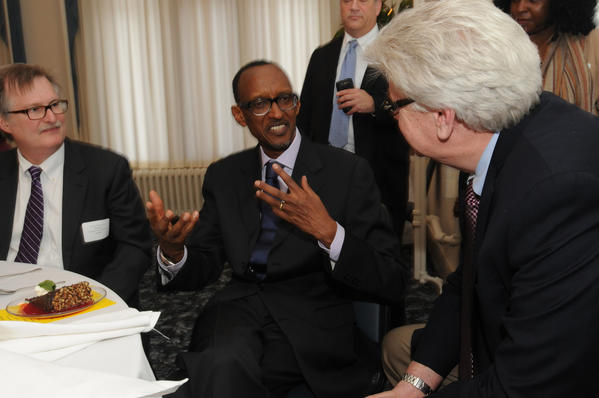 Rwandan President Paul Kagame, at center, talks to  Christopher ÒKipÓ Bergstrom, Deputy Commissioner, Connecticut Department of Economic and Community Development at a luncheon at St. Thomas Seminary in Bloomfield Tuesday afternoon. At left is K. Drake Klotzman, manager, business development - Helicopter Aftermarket Group, Kaman Helicopters.
