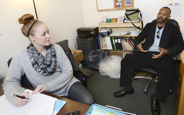 Arc's Jamie Schmidt, left, interviews job applicant Ernest Smith of Waynesboro, Pa., on Thursday at the Job Fair held at the Arc of Washington County in Hagerstown.