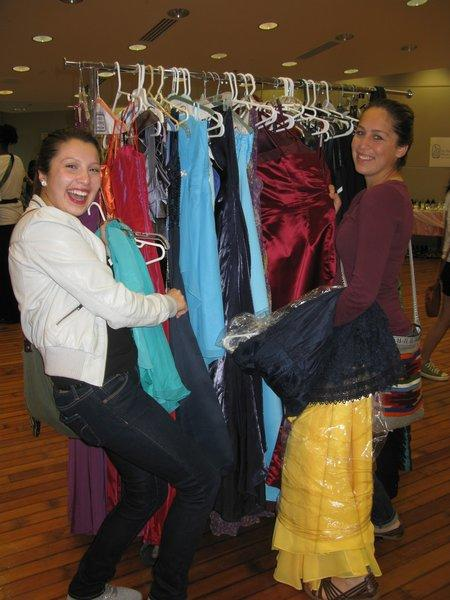 Two students try to find the perfect dress at last year's Prom Dress Project.