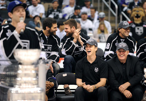 Then-AEG Chief Executive Tim Leiweke, right, and Kings President Luc Robitaille laugh during a speech by goalie Jonathan Quick during a Stanley Cup championship rally at the Staples Center last spring.