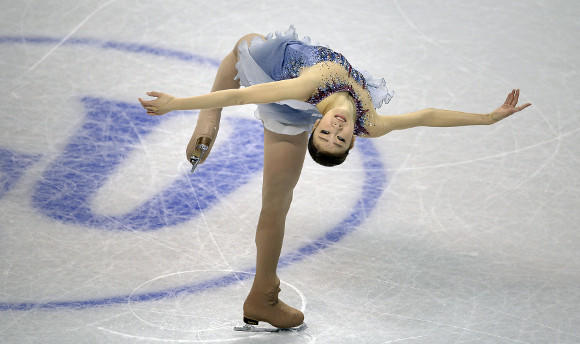 Yuna Kim spinning during Thursday's short program.  (Brendan Smialowski / AFP / Getty Images)