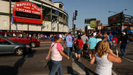 As the owners of the Chicago Cubs push to quickly wrap up a Wrigley Field rehab deal, the stadium's neighbors are calling for a slow down of the negotiations.
