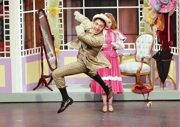 """Elias Cerdas (Barnaby Tucker) spins in the air as he dances in rehearsal for Laguna Beach High School's production of """"Hello, Dolly!"""" at the Artists Theatre."""