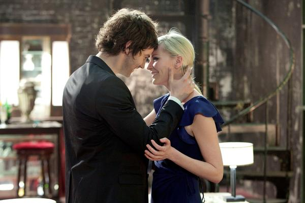 "Jim Sturgess, left, and Kirsten Dunst in ""Upside Down."""