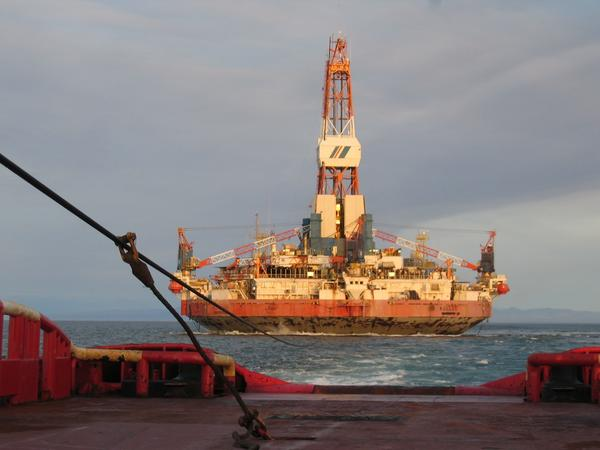 "The Kulluk rig drilling the ""top hole"" of an exploratory well in the Beaufort Sea before grounding in southern Alaska."