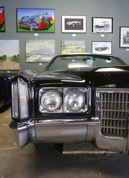 A black El Dorado Cadillac shows the design of yesteryear while parked on the showroom floor at Laguna Classic Cars and Automotive Art in Laguna Canyon.