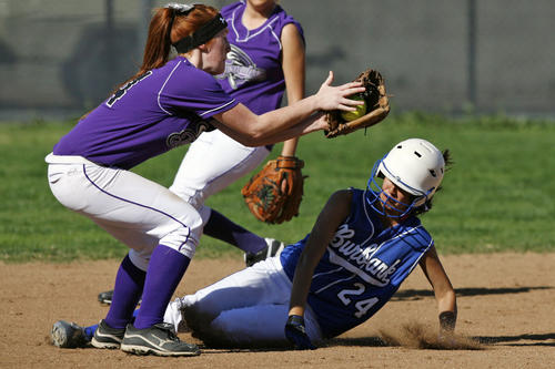 Hoover's Kaitlyn Williams, left, attempts to get Burbank's Tiffany Pisa out at second base, but is safe during a game at Hoover High School on Thursday, March 14 2013.