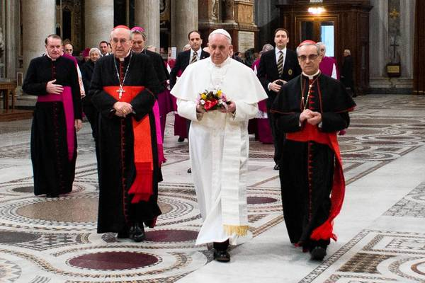 Pope Francis, center, arrives for a prayer at Rome's Basilica of Santa Maria Maggiore.