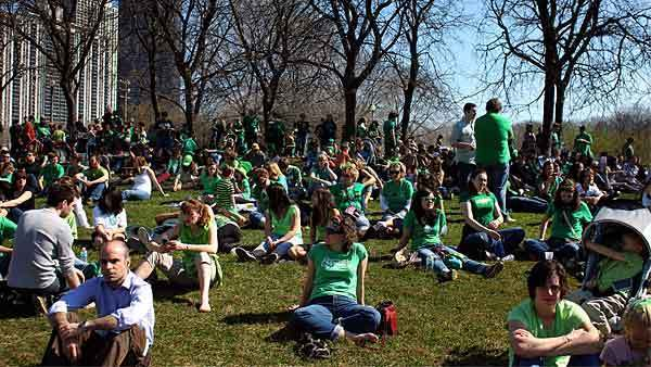 People wait along Columbus Drive for the start of the St. Patrick's Day Parade in downtown Chicago on Saturday March 17, 2012.