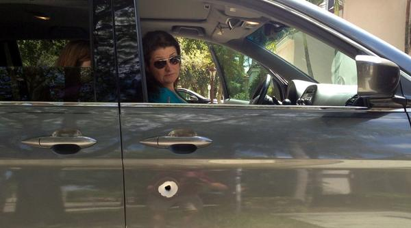 Laura Sheehy, 45, of Parkland, sits inside her family's van, which was hit by a bullet during last Friday's fatal police-involved shooting in Boca Raton, said her husband Andrew Sheehy.