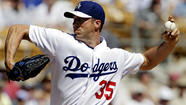 Chris Capuano was charged with five runs and six hits in 4 1/3 innings Thursday as the Dodgers fell to the Chicago Cubs, 8-1, at Camelback Ranch.