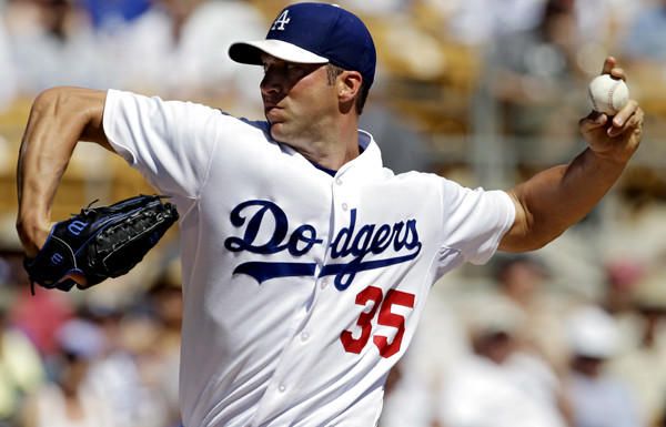 Dodgers starting pitcher Chris Capuano works against the Chicago Cubs in the first inning of a spring training game Thursday.