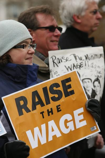 Protesters in Buffalo, N.Y. participate in a rally calling for a raise in the minimum wage.