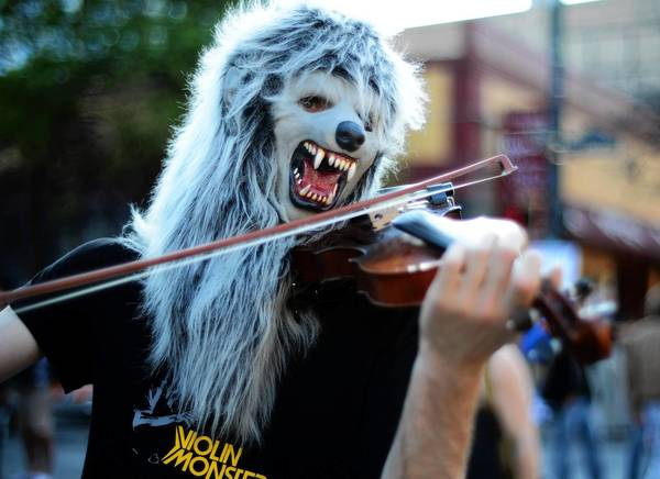 A musician performs on 6th Street during the SXSW Music, Film   Interactive Festival on March 13, 2013, in Austin, Texas.