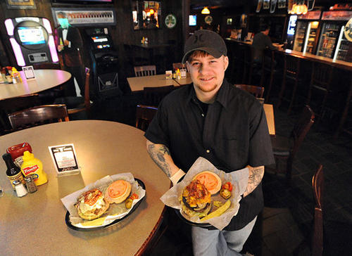 Head Chef Michael Gagney from the Beef Baron in Bethlehem with the half-pound burger and a bacon mushroom chicken sandwich served at the Beef Baron located in the Shopper's Village, Pennsylvania Ave. and Catasauqua Road in Bethlehem.