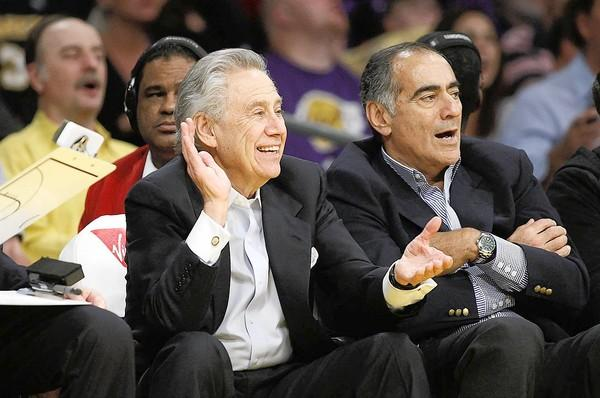 AEG chief Philip Anschutz, left, watches a Lakers-Timberwolves game at Staples Center in 2011.