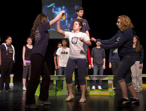 Wanda (center in white), played by Virginia Pope, is taunted by classmates as Notre Dame-East Stroudsburg rehearses their production of Wanda's World, written by Salisbury Township native Beth Falcone.
