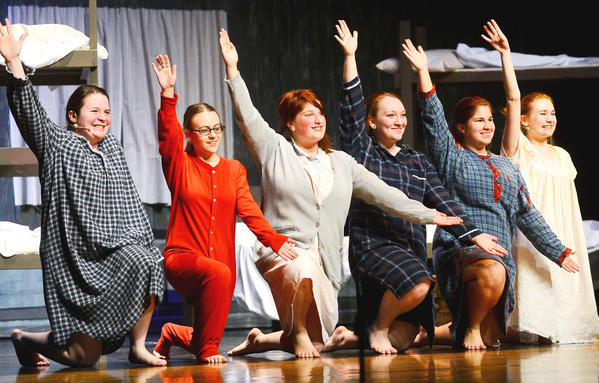"Members of the cast of ""Annie"" rehearse Thursday night at Waynesboro (Pa.) Area Senior High School."