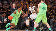NEW YORK — Notre Dame looked bad Thursday night. Also, the team's retina-scorching green uniforms were a bit fashion-challenged. But the central issue was the disjointed and apathetic players wearing them and yet another flume of disaster they unleashed upon themselves from the start.