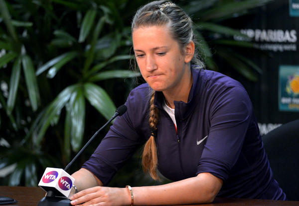 Victoria Azarenka pauses during a news conference Thursday to announce that she has withdrawn from the BNP Paribas Open tennis tournament because of an ankle injury.