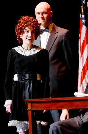 "Annie, played by Rebecca Reed, and Oliver ""Daddy"" Warbucks, played by Andrew Payne, are shown during Thursday's rehearsal of ""Annie."""